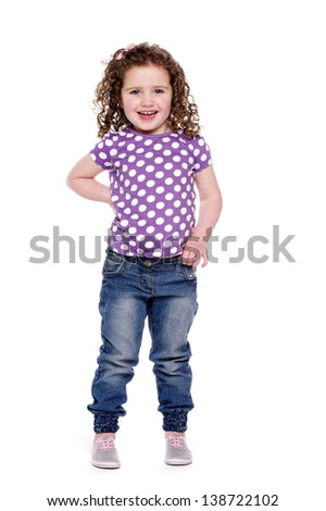 Young girl with her hand on her hip smiling at the camera, isolated on a white background