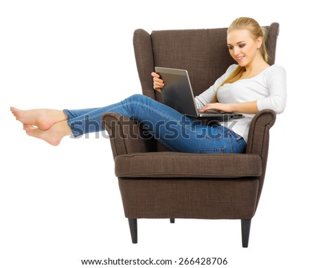 Young girl with laptop sit on chair isolated - stock photo