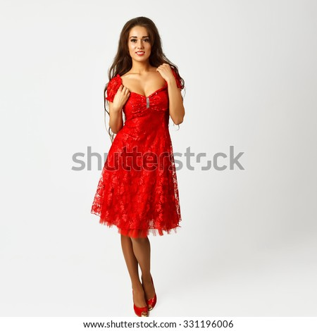 young girl with long hair in a beautiful dress