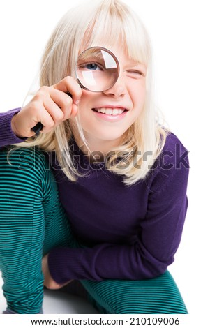 young girl with magnifying glass - stock photo