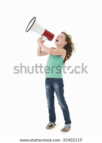 Young girl with megaphone on white background - stock photo