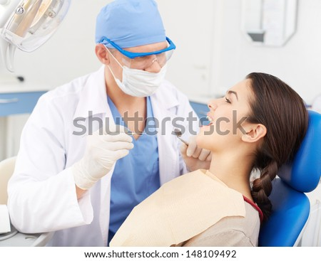 Young girl with open mouth before oral checkup at the dentist�¢??s
