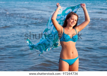 Young girl with pareo on the sea - stock photo