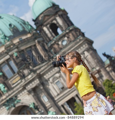 young girl with photo camera. Berlin background - stock photo