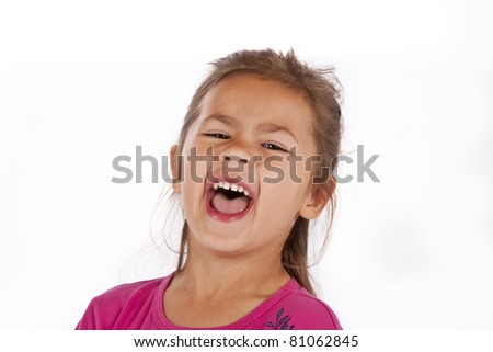 Young girl with pink dress in studio laughing closeup - stock photo