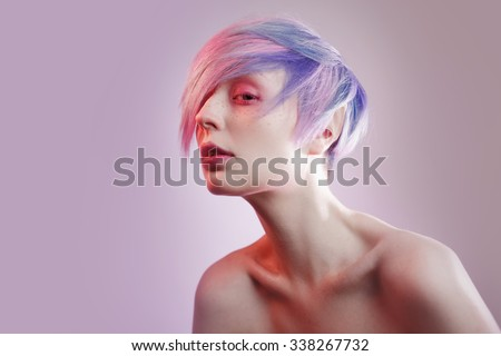 young girl with pink eyes and hair, like a doll - stock photo