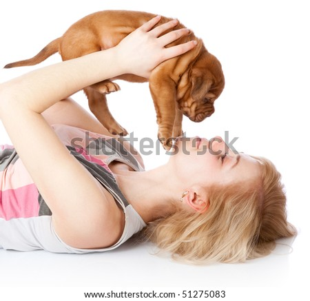 Young girl with puppy of Dogue de Bordeaux (French mastiff). Isolated on white background - stock photo