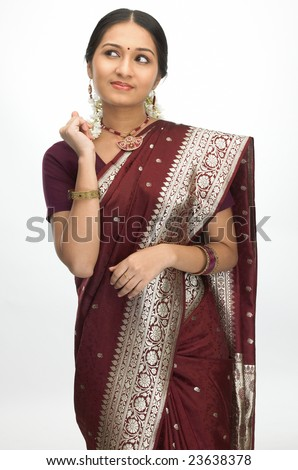 Young girl with sari in a thinking expression - stock photo