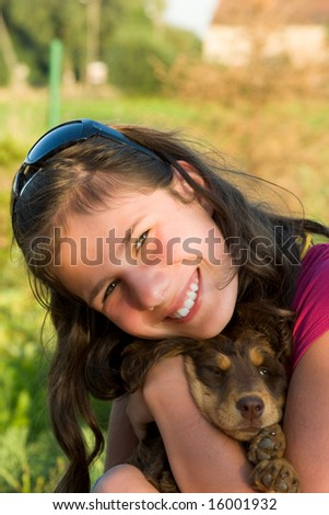 Young girl with small little dog on hands