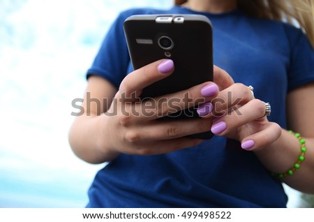 Young girl with Smartphone, modern teenage lifestyle.