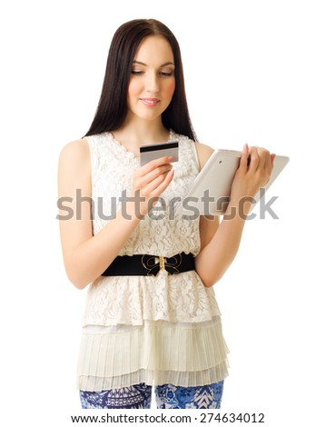 Young girl with tablet PC and credit card isolated - stock photo