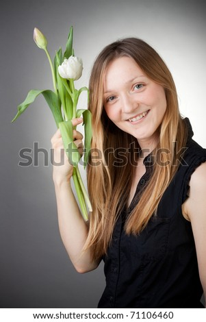 Young girl with tulips - stock photo