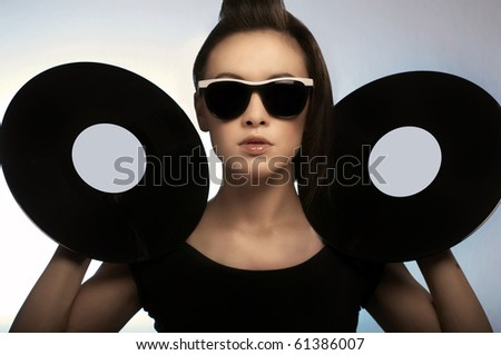 Young girl with two vinyl records - stock photo