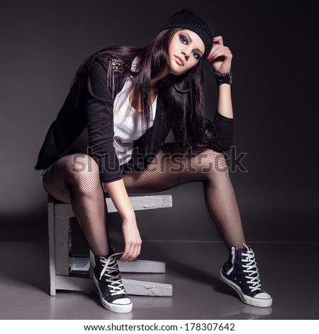 young girl with unique fashion sense looking away - stock photo