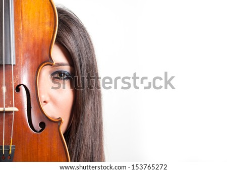 Young girl with violin against white background with copy space. - stock photo