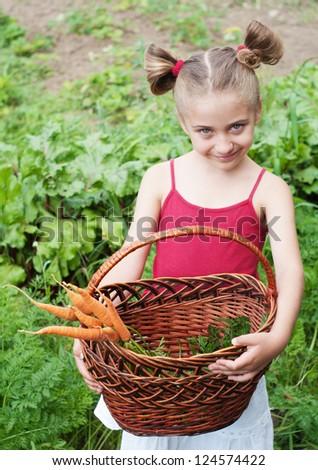 young girl working in vegetable garden - stock photo