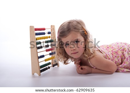 Young girl worrying about abacus - stock photo