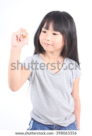 Young girl writing something with yellow pencil. - stock photo