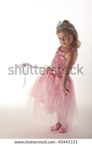 young girl (3 years old) dressed in pink fairy princess costume against white background - stock photo