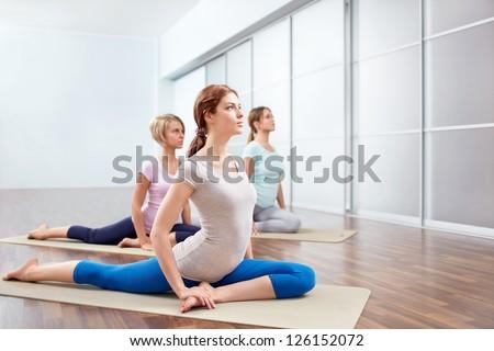 Young girls do yoga indoors - stock photo