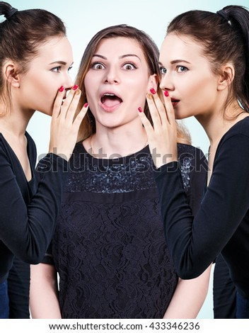 Young girls gossiping some secret - stock photo