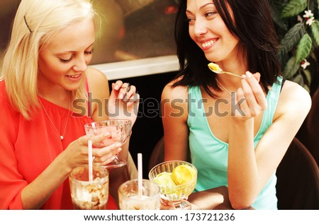 young girls having coffee break - stock photo