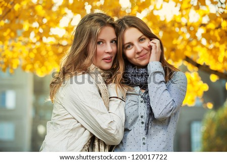 Young girls in an autumn park - stock photo