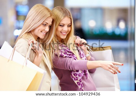 Young girls in shop windows - stock photo