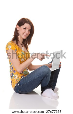 Young girls laughing and working on a laptop