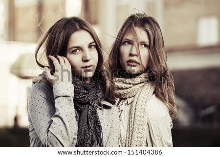 Young girls on the city street - stock photo
