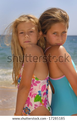 Young girls posing in the beach