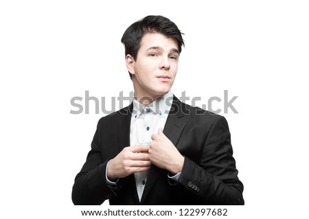 young glad caucasian businessman in black suit putting money into pocket isolated on white - stock photo