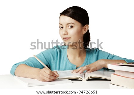 young good looking girl working hard over text books - stock photo