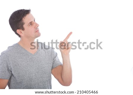 Young Good Looking Man in Gray Shirt Pointing Up Something, Isolated on White Background. - stock photo