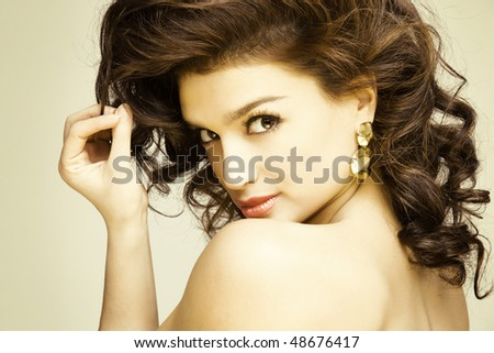 young gorgeous brunette model posing, studio shot - stock photo