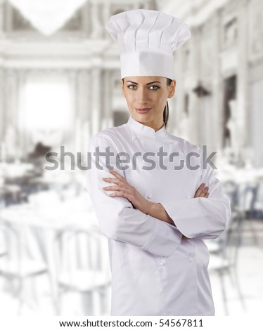 young graceful woman dressed as a cook with cap over white backgound - stock photo