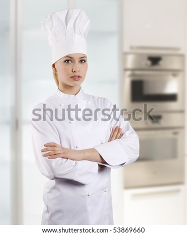 young graceful woman dressed as a cook with cap over white background