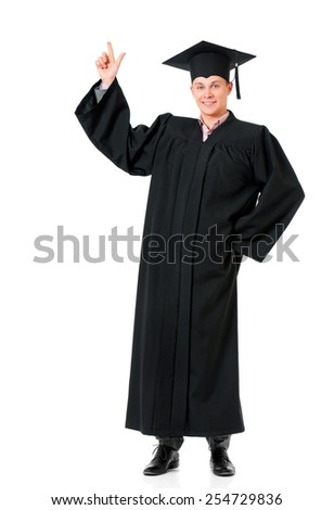 Young graduation man showing something, isolated on white background
