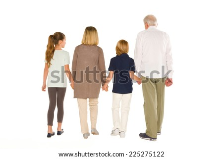 young grandmother grandfather with nephew and niece standing back on white background - stock photo