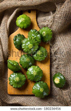Young green bush pumpkins on burlap