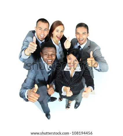 Young group of business people showing thumbs up signs in joy - stock photo