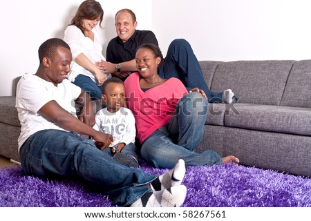 Young group of multiracial friends - two young families enjoying the afternoon. - stock photo