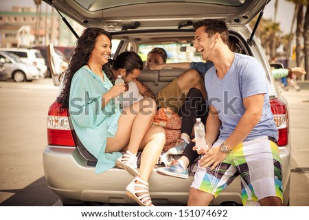 Young group of people traveling stopping for a ice cold water - stock photo
