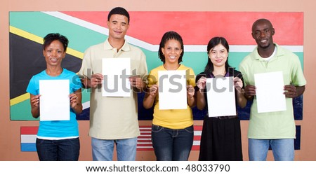 young group of South African people holding blank signs before South Africa flag, 2010 Fifa world cup concept - stock photo