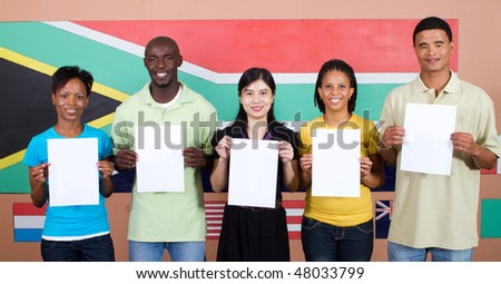 young group of South African people holding blank signs before South Africa flag, 2010 Fifa world cup concept