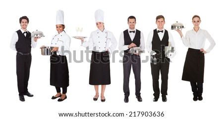 Young Group Of Waiters And Waitress Over White Background - stock photo