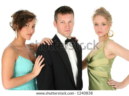 Young group, one man and two women, in formals over white. - stock photo