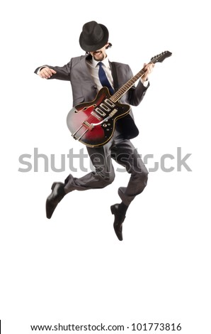 Young guitar player isolated on white - stock photo
