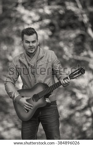 young guitarist black and white photography - stock photo