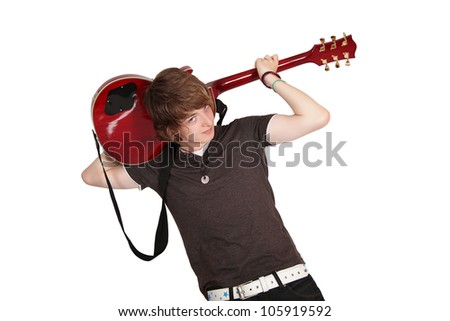 Young guitarist playing guitar behind his head, isolated on white - stock photo